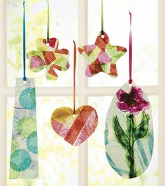 Modpodge Suncatchers layers of paper then podge, allowed to dry, and sharpie as lead lines