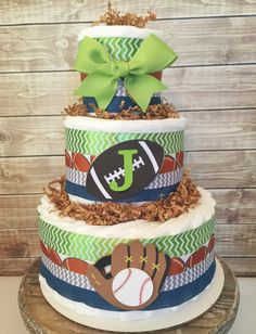 Sports Theme Diaper Cake, Sports Baby Shower Centerpiece, Sports Deocrations by AllDiaperCakes on Etsy https://www.etsy.com/listing/463009108/sports-theme-diaper-cake-sports-baby