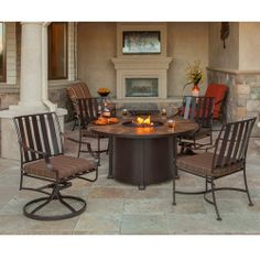 OW Lee's Santorini Dining-height fire pit table is the centerpiece of this Laredo set. Wrought iron base supports a porcelain tile top, and table surface accommodates up to 4 people.