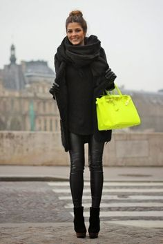 All black outfit with a pop of color with the neon handbag. | Winter Style