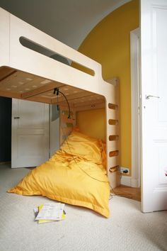 birch plywood and pine in kids' rooms: rafa kids bed in a yellow room