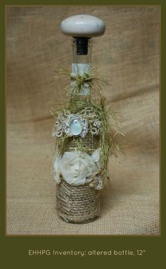 Altered bottle, 1800's doorknob cap, organza ribbon, marble, yarn, frayed burlap, vintage lace