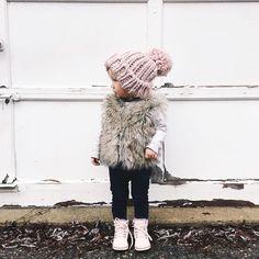 mini fashionista -- so cute in that faux fur vest!