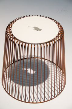 """Tweet is an indoor/outdoor stool designed by Ji-in Kim. The bird cutout in the seat becomes an illuminated shape inside the wire base, which resembles a bird cage. When someone sits on the stool the bird disappears and as Kim says is set free."" via PSFK"