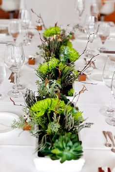The lush and modern centerpieces look lovely on the rectangle tables.