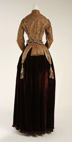 Dress Date: 1882–83 Culture: American Medium: silk Dimensions: Length at CB (a): 24 in. (61 cm) Length at CF (a): 14 in. (35.6 cm) Length at...