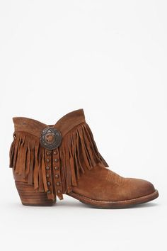 Looks like my white cowgirl boots and my tan fringe ones got ...