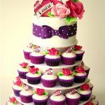 rockabilly cupcake wedding cakes with flower topper
