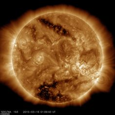 NASA's Solar Dynamics Observatory, or SDO, captured this solar image on March 16, 2015, which clearly shows two dark patches, known as coronal holes. Coronal holes are regions of the corona where the magnetic field reaches out into space rather than looping back down onto the surface - and eject solar winds far faster than other parts of the sun.