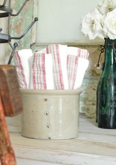 Stoneware utensil crock with dish towels