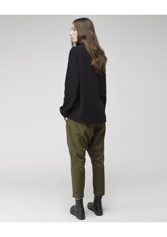 Was Trouser by Hope.  Slouchy, oversized trousers that narrow at the foot.  Worn with / Hope Patti Sweater & Hope Danny Boot.
