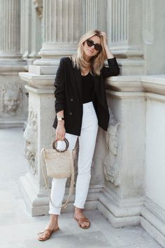 Black blazer, a black bodysuit, white jeans, brown sandals, a straw bag and black cat eye sunglasses. Spring outfit, summer outfit, simple outfit, black and white outfit, easy outfit, fashion 2018, fashion trends 2018, street style, casual outfit, work outfit #fashion2018 #streetstyle #springstyle #summerstyle #casualstyle #blazer #hermes #stylish #fashiontrends2018