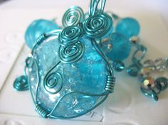 now that i know how to crack marbles and wire wrap jewelry, i HAVE to make something like this!