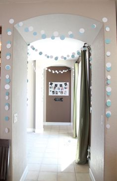 Paper garland - very simple, but beautiful decor for a baby shower!