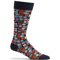 Mondrian's squares, squared. Made In: Japan Content: 97% Nylon / 3% Polyurethane Size: Our men's sock translates to an 8-12.5 shoe size. Because of the stretch in our socks, those with a slightly larg