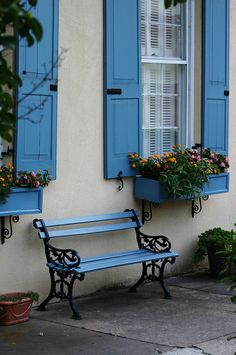 Blue shutters and flowerboxes