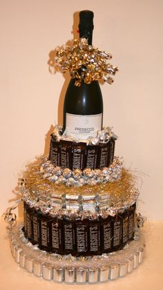 Chocolate Candy/ -could have something other than wine at top and be just chocolate candy tower by bridgette.jons