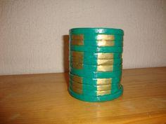 1 lapicero verde oro