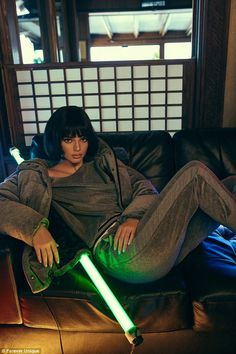 Comfy: Supermodel Kendall appeared in the shots posing in a grey velour-inspired look...