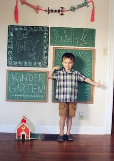 Chalkboard photo wall. Change the message and the face for any picture-worthy event.