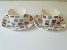 A pair of Samba Cups and Saucers on the Patio shape