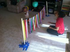 Net made from streamers and wrapping tubes for balloon volleyball and 6 other tot friendly sports made from wrapping paper tubes.