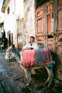Man with Donkey in Fes | photography by http://www.sasithonphotography.com/