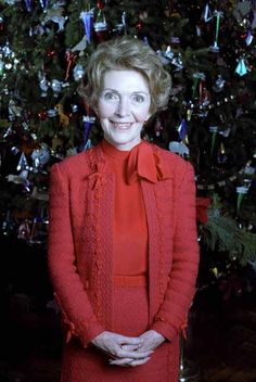 Nancy Reagan in front of the White House Christmas Tree in the Blue Room. 12/7/81.  http://www.reagan.utexas.edu/archives/photographs/mrs.html
