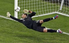 Portugal goalkeeper Rui Patricio fails to save a shot by Spain's Gerard Pique, unseen, in the penalty shootout of the Euro 2012 soccer championship semifinal match between Spain and Portugal in Donetsk, Ukraine on Thursday.