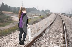 Leaving young woman with a white umbrella