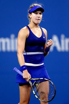 Eugenie Bouchard Photos: US Open: Day 4. Eugenie Bouchard of Canada celebrates her win against Sorana Cirstea of Romania on Day Four of the 2014 US Open at the USTA Billie Jean King National Tennis Center on August 28, 2014 in the Flushing neighborhood of the Queens borough of New York City.