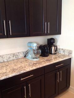dark espresso cabinets with granite countertop and 5 12 inch granite backsplash