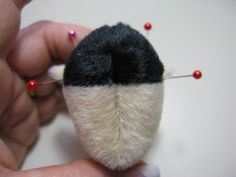 Start by matching 2 ear pieces together, pin and then stitch around the curved edges. Leave the straight edges open. Turn them right side ou...