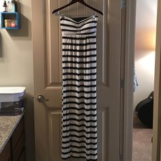 Striped strapless maxi dress Strapless striped maxi dress with removable bra padding and thick black elastic strap along the back showing some open back detail. Super soft and stretchy material. Flowy. Size XS but fits small/medium. 95% viscose. 5% spandex. Remain Dresses Maxi