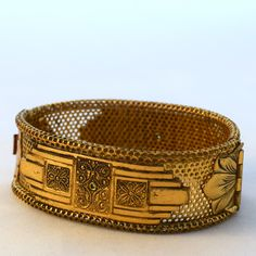 A personal favorite from my Etsy shop https://www.etsy.com/listing/385686726/antique-wide-gold-bangle-bracelet-art