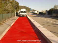 realizzazione pista ciclabile in vernice rossa - segnaletica orizzontale
