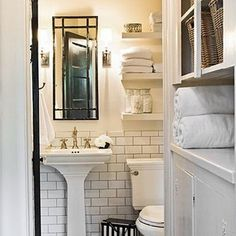 narrow pedastal sink and shelves over toilet for storage