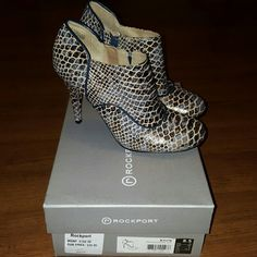 Brand New Rockport Shoes In The Box size 8.5 heels Brand New In The Box Rockport Shoes size 8.5 Heels. Never Worn side zip. Rockport Shoes Heeled Boots