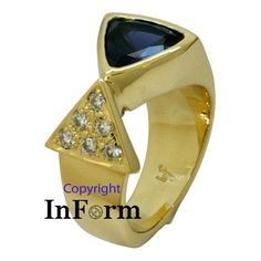 Yellow gold ring with triangular Iolite