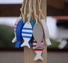 Wooden fish decorations- in different colors than these! Fish Crafts, Beach Crafts, Wood Fish, Fish Sculpture, Beach House Decor, Nautical Theme, Beach Themes, Bunting, Mobiles