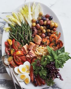 The idea behind this beautiful and delicious salad is to use up all the remnants left in your refrigerator from the weekend's meals. Hard-boiled eggs, along with anchovies and olives, bring the salad closer to its origin in the south of France.