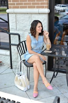 Crossed legs on cafe