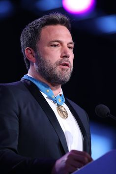 Ben Affleck Photos - Ben Affleck speaks on stage at the 2017 Starkey Hearing Foundation So the World May Hear Awards Gala at the Saint Paul RiverCentre on July 2017 in St. - 2017 Starkey Hearing Foundation So the World May Hear Award Gala