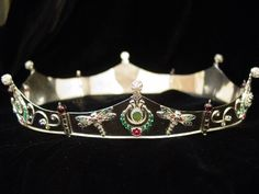 #21 - Baronial Coronet in sterling silver and enamel, with Laurel wreaths and dragonflies.  Set with emeralds, cultured freshwater pearl, and garnet.