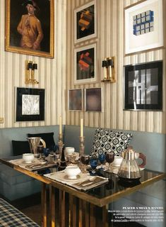 Room of the Day: Lorenzo Castillo' Madrid home. Striped wall paper, cozy pale blue banquette, gallery wall. 6.9.2013