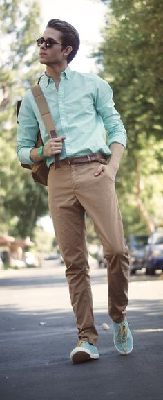Shop this look for $162:  http://lookastic.com/men/looks/chinos-and-belt-and-backpack-and-longsleeve-shirt-and-low-top-sneakers/1772  — Khaki Chinos  — Dark Brown Leather Belt  — Brown Backpack  — Aquamarine Longsleeve Shirt  — Aquamarine Low Top Sneakers