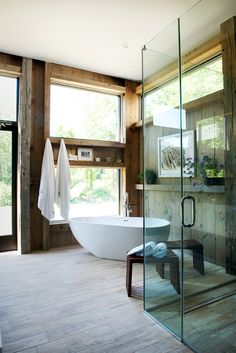 A Victoria + Albert freestanding bathtub sits beside the window, while the custom-made glass shower is set a few feet away. (Phone: Jane Beiles for The New York Times)