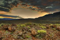 Africa | Karoo. Sunset in Karoo National Park, South Africa. The Karoo (a Khoisan word of uncertain etymology) is a semi-desert region of South Africa. It has two main sub-regions - the Great Karoo in the north and the Little Karoo in the south. | © Mario Moreno