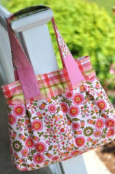 Love how this bag turned out. The floral on the bottom is vintage Fruit of Loom fabric. It was given to me by my simply awesome blogging friend, Karen.   Made using this pattern: thinkliz.com/2009/02/20/diana-hobo-free-pattern/  To be Blogged Thursday June 30, 2011 www.pleasant-home.com