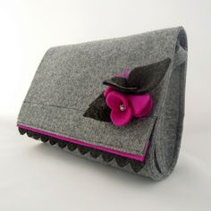 This is a designed and made by me a medium size felt bag. It is decorated by a Brooch. Looks really nice :) I'm sure you are going to like it! It was made taking care of each small detail. Size...